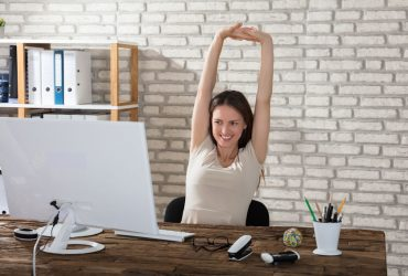 A women in the office stretching