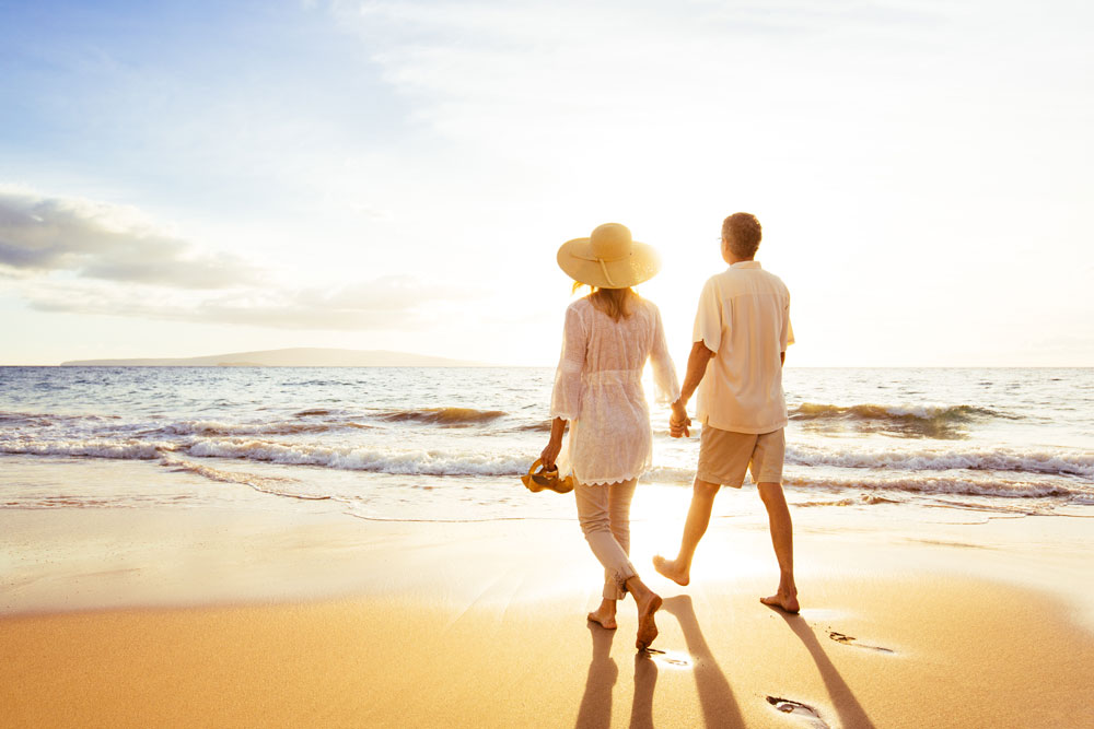 A loving couple going for a stroll along the beach