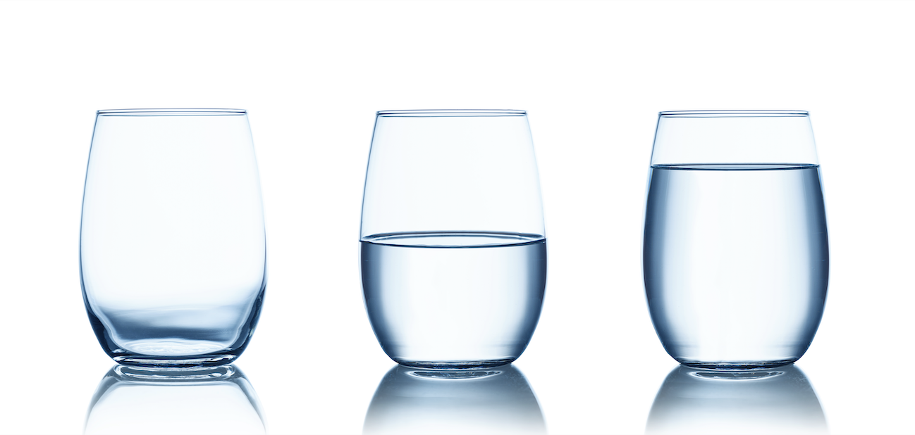 Three glasses of water all in a row.
