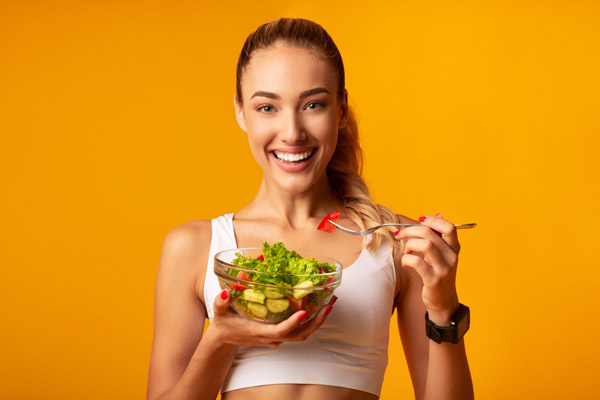 Fitness Girl Eating Vegetable Salad